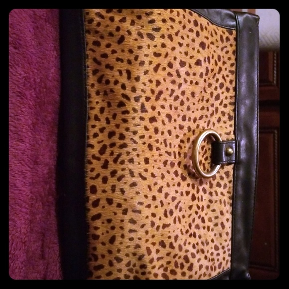 Banana Republic Handbags - Bananas Republic leather cheetah print clutch